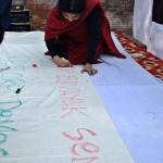 A protest banner is hand drawn by an organiser at the Delhi protest of artists for human rights, 15 January 2011